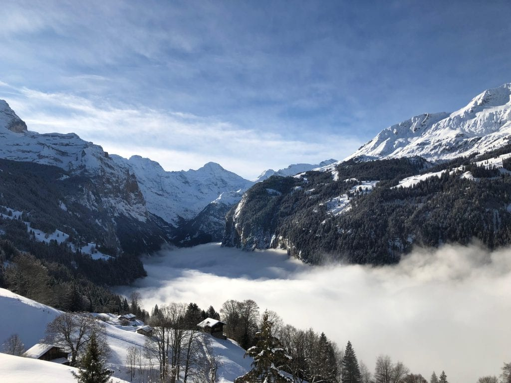 Image of the mountains and fog on the train ride up to Grindelwald Switzerland.